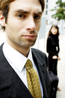 Man in business suit looking at camera