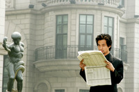 Man in business suit reading newspaper
