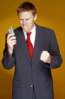 Man in business suit talking angrily on the hand phone