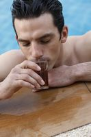 Man in pool drinking tea