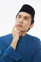 Man in traditional clothing contemplating