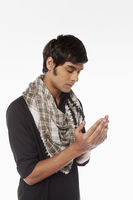 Man in traditional clothing praying