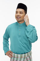 Man in traditional clothing talking on mobile phone