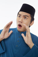 Man in traditional clothing with a shocked facial expression