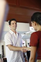 Man shaking hands with hotel receptionist