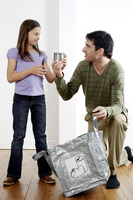 Man teaching girl about recycling