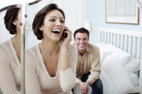 Man watching his wife talking on the phone
