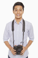 Man with digital camera, smiling