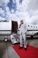 Man with headset standing by private jet