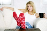 Mature lady wearing a pair of red flowery sock