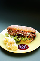 Meat salad sandwich with mashed potatoes and cranberry sauce