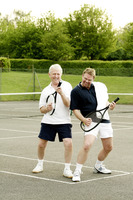 Men playing with tennis racquet