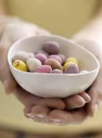 Mini eggs in bowl with model