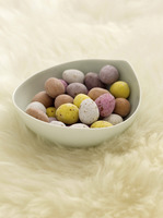 Mini eggs on sheepskin rug