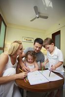 Parents helping children to colour
