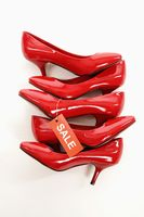 Red stilettos with sale label