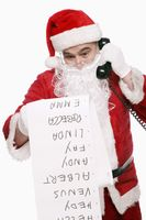 Santa claus talking on the phone while reading checklist
