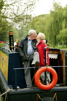 Senior couple kissing on their houseboat