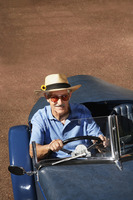 Senior man driving in his car