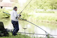Senior man fishing by the river