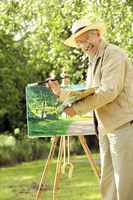 Senior man holding paintbrush and a palette