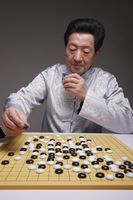 Senior man playing japanese board game