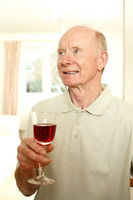 Senior man with a glass of red wine