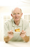 Senior man with a slice of cake