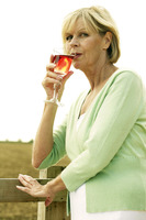 Senior woman drinking a glass of red wine