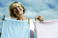 Senior woman hanging laundry on washing line