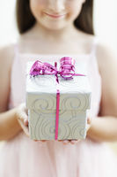 Popular : Smiling girl with gift mid section close up