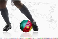 Soccer player dribble a soccer ball with cameroon flag