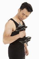 Strong man lifting dumbbells