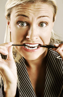 Tensed up woman biting a pen