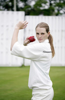 Woman about to throw a cricket ball