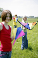 Woman and her children holding kites
