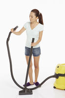 Woman attaching the grip of a vacuum cleaner