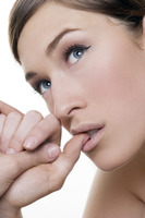 Woman biting her fingernail