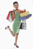 Woman carrying a stack of gift boxes and shopping bags