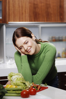 Woman daydreaming in the kitchen