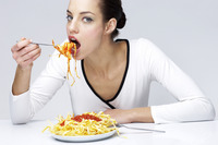 Woman eating pasta