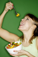 Woman enjoying a bowl of salad