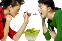 Woman feeding her friend