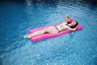 Woman floating on lilo
