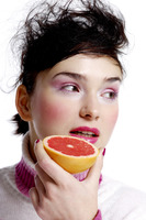 Woman holding a blood orange
