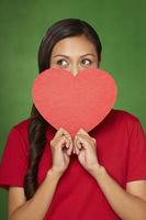 Woman holding a cut out heart