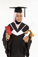 Woman holding a passport and graduation scroll