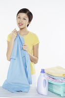 Woman holding a piece of clean laundry