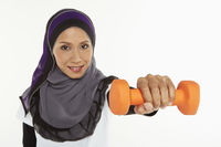Woman holding out a dumbbell