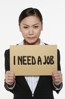 Woman holding placard with text 'i need a job'